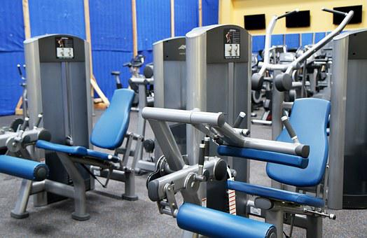 Gym room showing fitness equipment to signify weight loss