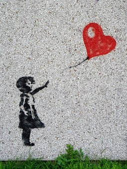 An image of a child releasing a balloon, in regards to this article about saying goodbye.