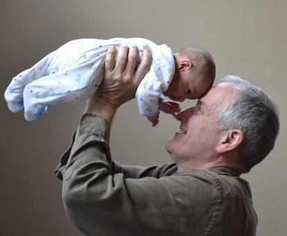 An image of grandpa with his infant grand-baby.