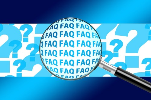 Magnifying glass zooming in on FAQs