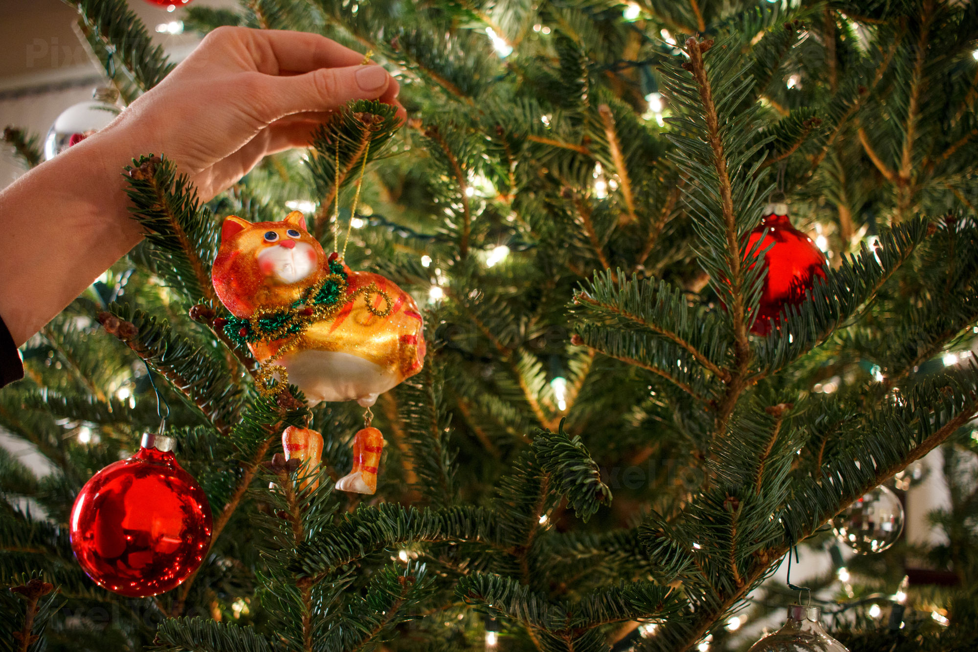 woman hanging ornament on