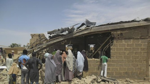 FILE PHOTO: People gather at the site of suicide bomb attack at Redeem Christian church in Potiskum, Nigeria, Sunday, July 5, 2015. (AP Photo/Adamu Adamu)