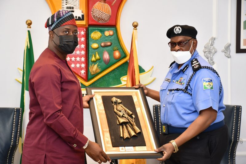 Oyo State Governor, Seyi Makinde (left), presenting a frame to the Assistant Inspector General of Police in charge of Zone XI, Olasupo Ajani Babatunde, during a courtesy visit to the Governor's Office, Secretariat, Ibadan