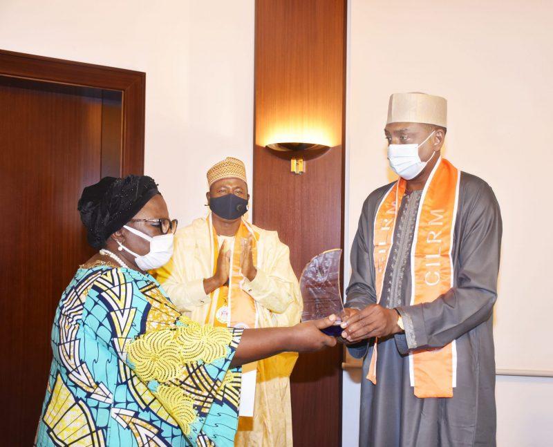 State House Permanent Secretary, Mr Tijjani Umar receiving a plaque