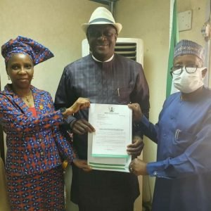 Professor Bissallah Ahmed Ekele: flaunts his appointment letter as Chief Medical Director of the University of Abuja Teaching Hospital