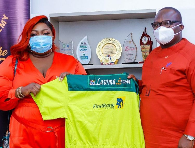 Eniola Badmus with MD/CEO, LAWMA, Ibrahim Odumboni at the unveiling