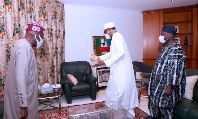 Have your seat: Buhari gestures to Tinubu
