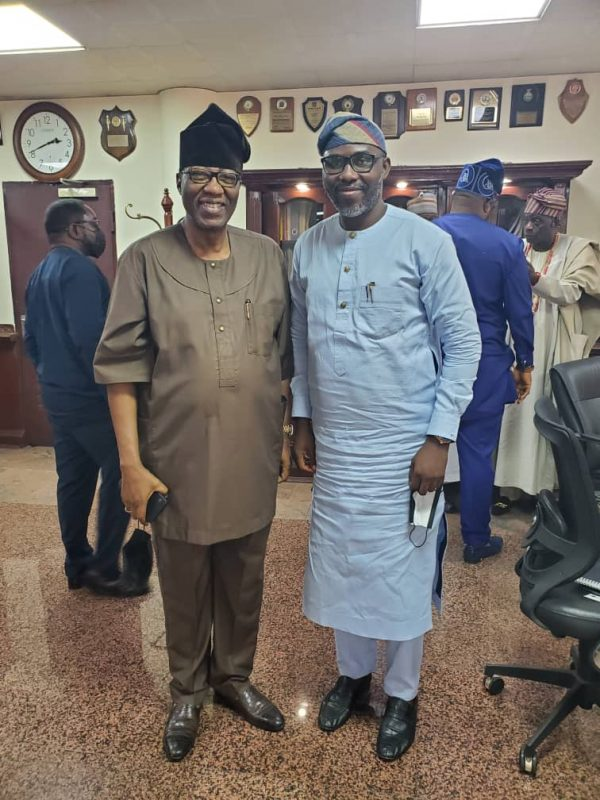 Otunba Gbenga Daniel with an official of the Tinubu Support Organisation