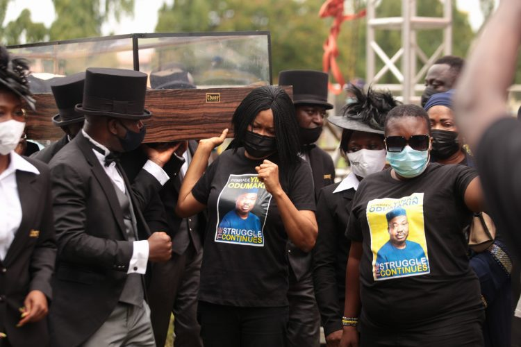 Dr. Joe Okei-Odumakin joining the Pall-bearer to convey the remains of her husband to the Police College