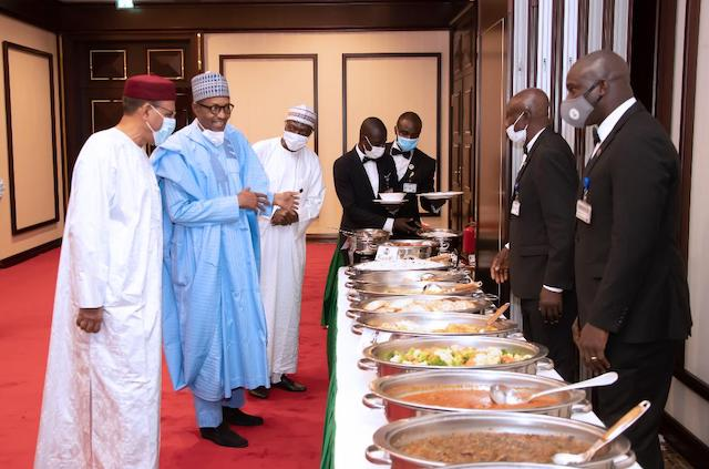 Time for the main meal: Buhari and his guest Bazoum