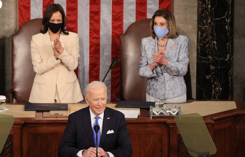 L-R: VP Kamala Harris and Speaker Nancy Pelosi cheer President Biden