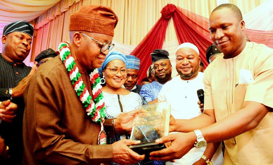 Governor Adegboyega Oyetola, receiving an award of excellence from the Chairman, Nigeria Labour Congress (NLC), Comrade Jacob Adekomi