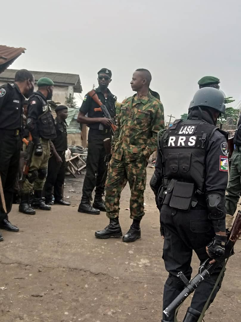 Operatives of the Lagos State Rapid Response Squad (RRS) on ground to restore normalcy in Mile 12 on Thursday.
