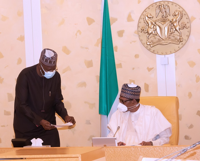 President Muhammadu Buhari Confers with the SGF Mr. Boss Mustapha during a virtual FEC Meeting held at the State House Abuja. PHOTO; SUNDAY AGHAEZE. MAY 5TH 2021