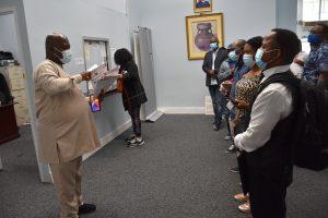 Amb. Lot Egopija attending to passport applicants at Nigeria House in New York