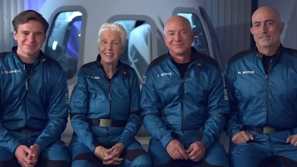 Jeff Bezos, 2nd right, his brother Mark, Wally Funk, 2nd left and Oliver Daemen