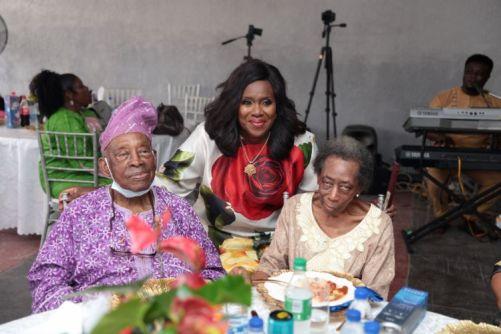 Mr Femi Bucknor, Mrs Remi Bucknor with the celebrant