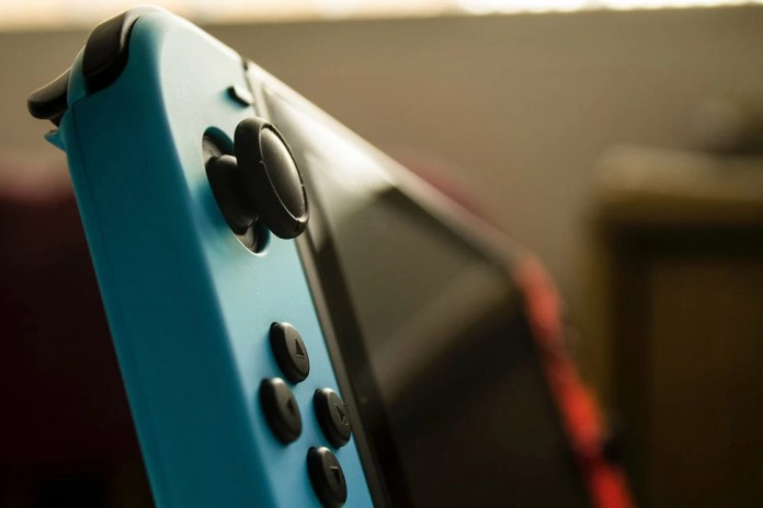 Nintendo Switch Pro specs, release date, rumours and features game in hand