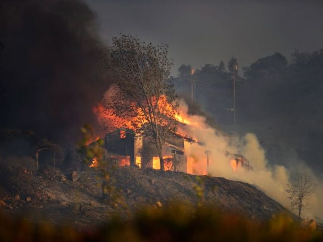 A home burning on top of a hill in San Marcos in San Diego County in May 2014