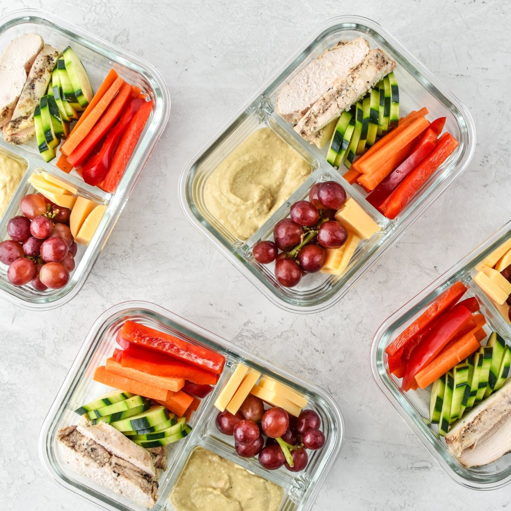 medium resolution of four chicken hummus plate lunch meal prep meals ready to be eaten