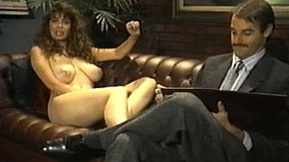 Curly brunette with big natural tits in action Preview Image