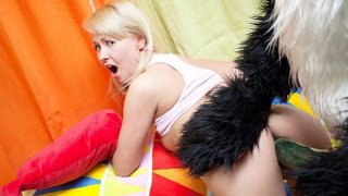 Teddy bear with a black cock in her mouth gave the blonde Preview Image