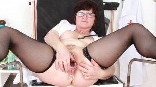 Brunette practical nurse_examining her vagina Preview Image