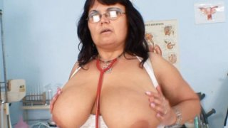 Huge tits Milf nurse shows off her big mellons Preview Image