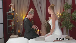 Redhead lesbian fucked_on massage table Preview Image