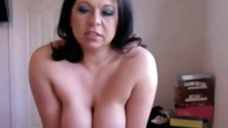 Brunette busty milf Riding her sex toy on_webcam Preview Image
