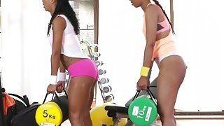Fit ebony lesbians finger fucking at the gym Preview Image