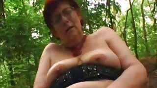 Sex crazed granny Tamara greedily sucks hard dick and gets fucked in park Preview Image