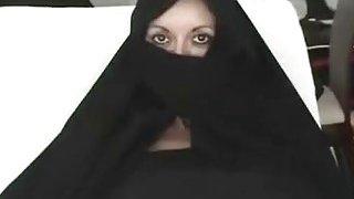 Iranian Muslim Burqa Wife gives Footjob on Yankee Mans Big American Penis Preview Image