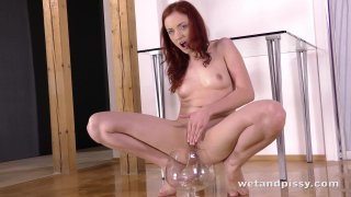 Pussy Pissing Redhead Marketa tastes her piss in solo watersports video Preview Image
