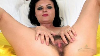 Amazing MILF teases with her hairy cunt and masturbates solo Preview Image