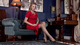 Pin-up blonde shows off on a sofa Preview Image