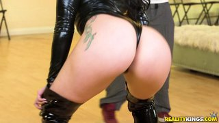 Phat ass babe in latex face sits on horny hunks Preview Image