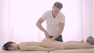 Brunette enjoys a deep drilling on a massage table Preview Image