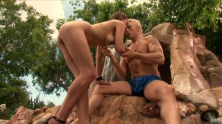 Slutty nympho Poppy Morgan sucks a cock near the waterfall Preview Image