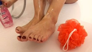 Sweet blonde gal Suzie Carina washes her feet in a hottub Preview Image
