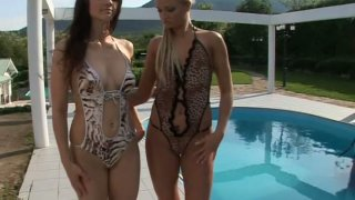 Aletta Ocean and Ksara in mini bikini by pool side Preview Image