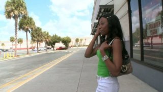 Slim black chick Courtney Foxxx seduces a man in the street Preview Image