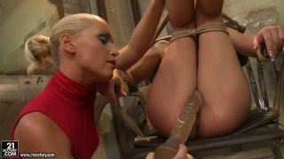 Kathia Nobili pleases the wet pussy of tied brunette Bianca Arden Preview Image