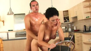 Flabby brunette MILF Inka rides Ryan's young cock on the floor Preview Image