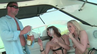 Eliska Cross and Angel Long blow the dick of the yacht owner Preview Image