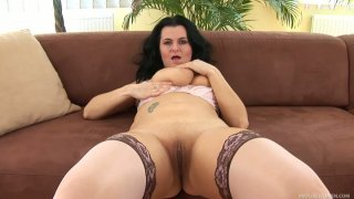 BBW mature mommy Reny strokes her fat pussy on the brown couch Preview Image