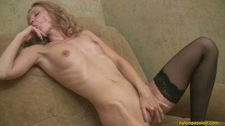 Skinny curly blondie Lada masturbates being alone at home Preview Image