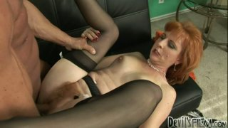Redhead cougar Sasha Brand in black stockings gets her cunt railed on the couch Preview Image