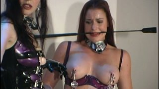 BDSM queen Anastasia Pierce punishes and spanks bootylicious redhead Preview Image
