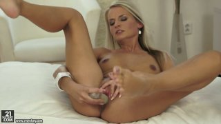 Straight haired blondie Jessie Jazz sucks a dildo with delight Preview Image